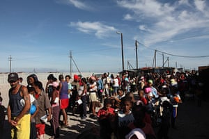 Blikkiesdorp, Cape Town: 1200 people queue at a food handout station