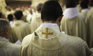 Catholic priests pray