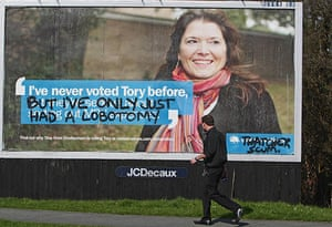 Election posters: Grafitti spray painted onto a Conservative Party election poster