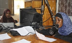 Horn Afrik Radio presenters read the news at a studio in Mogadishu