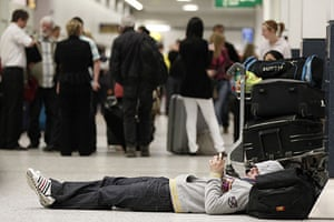Iceland volcano eruption: Passengers wait, after flights were disrupted, in Manchester Airport