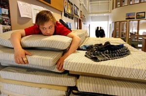 Iceland volcano eruption: A youth lies on mattresses at the South Iceland Care centre