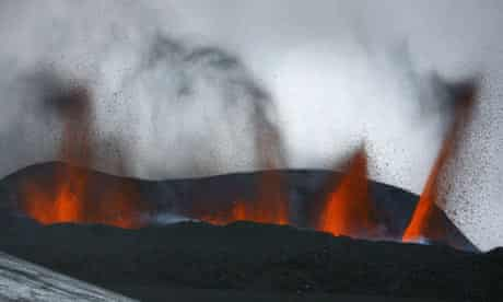 Lava spews out of a mLava spews out from a mountain in the Hvolsv llur region of Iceland