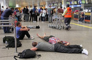Volcano disruption: Passengers wait at Faro airport in Portugal
