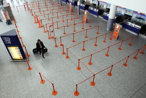 Volcano disruption: A woman walks in the empty departure hall at Bristol Airport