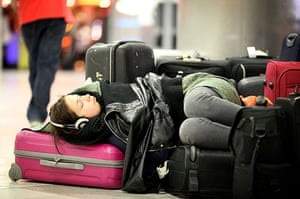 Iceland volcano: A girl sleeps in the departure lounge at Gatwick airport