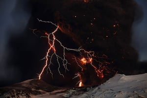 Volcano in Iceland: Lightning streaks across the sky as lava flows from a volcano