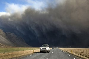 Volcano in Iceland: Motorists drive on a road as the Eyjafjallajokull volcano
