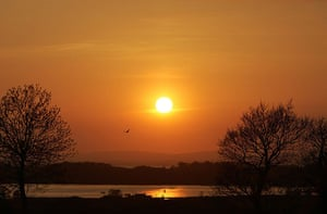 Volcanic sunsets: The sun sets over Lough Neagh, with a warmer than normal glow