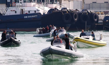 Travellers arrive from France at Dover on speedboats