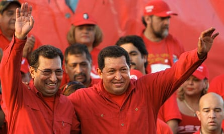 Hugo Chávez waves to supporters in Barinas with his state governor brother Adán
