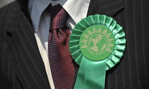 A rosette on a Green party worker canvassing in the Primrose Grove area of Norwich