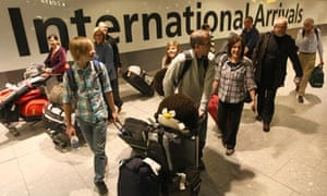 Passengers arrive at Heathrow airport after flying in on a British Airways flight from Vancouver.