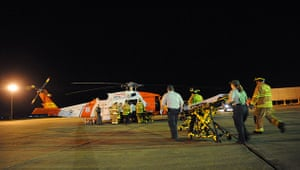 Deepwater Horizon oil rig: emergency medical technicians rush a gurney to a rescue helicopter