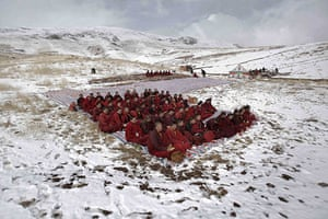 24 hours in pictures: Jiegu, China: Tibetan monks attend a mass prayer for earthquake victims