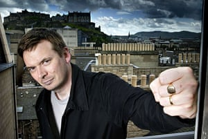 Literary Edinburgh: Crime writer Ian Rankin on a balcony over looking Edinburgh Castle