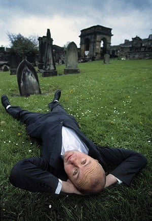 Literary Edinburgh: Irvine Welsh poses in a cemetry in Edinburgh