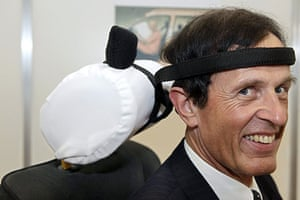 Exhibition of Inventions: Hartmut Schmuecker with his invention, a head safty belt for car drivers