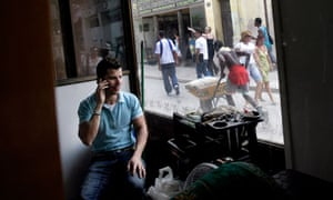 A man talks on his phone in Old Havana, Cuba