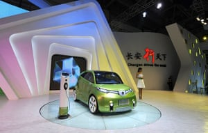 Beijing car show: A model stands next to Chinese car maker Chang'an's electronic-energy car