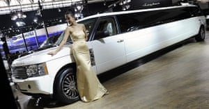Beijing car show: A model poses next to a stretched Range Rover