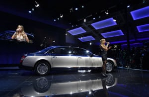 Beijing car show: Leona Lewis performs while standing next to a Daimler Maybach