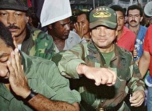 Manuel Noriega: 2 May 1989: General Manuel Antonio Noriega fakes a punch to a supporter