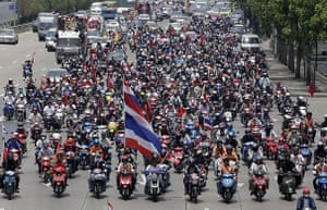 Thailand protests: Anti-government red-shirt protesters carry Thai national flags