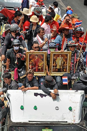 Thailand protests: Red Shirts in the convoy hold portraits of the Thai king and queen
