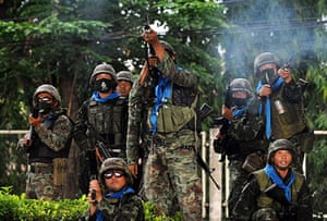Thailand protests: Thai soldiers shoot into the air during a clash with Red Shirts