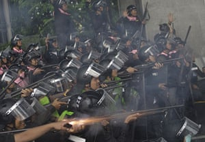 Thailand protests: Thai riot police open fire as they see approaching motorcycles on a highway