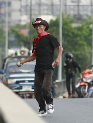 Thailand protests: Anti-government protester throws rocks at security forces