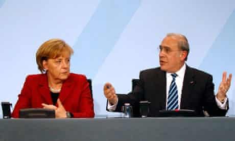 Angela Merkel and Angel Gurria