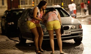 A young woman assists a friend during a Carnage student pub crawl event in Lincoln