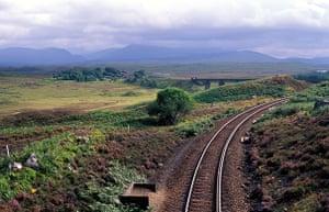 10 best train journeys: Railway line passing through Rannoch Moor Highlands Scotland UK