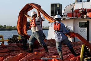 Deepwater oilrig: Workers load oil booms on boat in the Gulf of Mexico