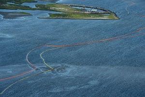 Deepwater oilrig: Oil booms snake around land in Breton Sound in Louisiana