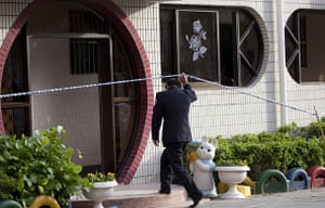 China school violence: A police officer enters a building where students were attacked in Taixing