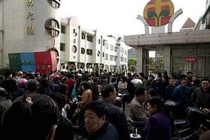 China school violence: People gather outside the gate of Zhongxin Kindergarten