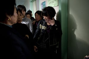 China school violence: A mother of a child who was attacked at the Zhongxin Kindergarten cries