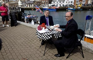 Martin Argles campaign: Gordon Brown and Nick Robinson by the harbour in Weymouth