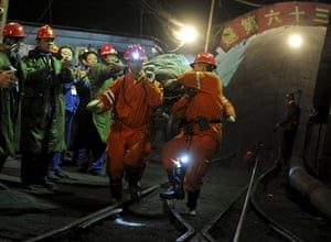 Miners rescued in China: A survivor is rescued out of the flooded Wangjialing Coal Mine  in China