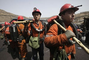 Miners rescued in China: Rescuers  at Wangjialing Coal Mine in China