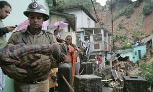 rio flood firefighter injured baby