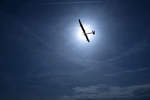 Solar Impulse: Solar Impulse is silhouetted by the sun during its maiden flight