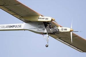 Solar Impulse: Test pilot Markus Scherdel gains altitude after he took off
