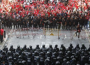 Thailand protests: Anti-government demonstrators, walk near a police line in downtown Bangkok