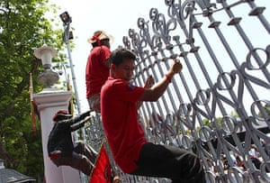 Thailand protests: Anti-government protesters climb over the gate to get into Parliament