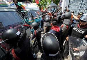 Thailand protests: Red Shirt supporters in vans clash with riot-policemen outside parliament