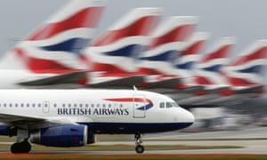 A British Airways plane lands at Heathrow Airport.